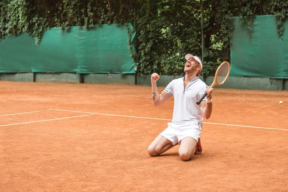 stock-photo-blond-winner-racket-celebrating-kneeling.jpg